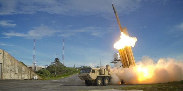 The first of two Terminal High Altitude Area Defense (THAAD) interceptors is launched during a successful intercept test. The test, conducted by Missile Defense Agency (MDA), Ballistic Missile Defense System (BMDS) Operational Test Agency, Joint Functional Component Command for Integrated Missile Defense, and U.S. Pacific Command, in conjunction with U.S. Army Soldiers from the Alpha Battery, 2nd Air Defense Artillery Regiment, U.S. Navy sailors aboard the guided missile destroyer USS Decatur (D