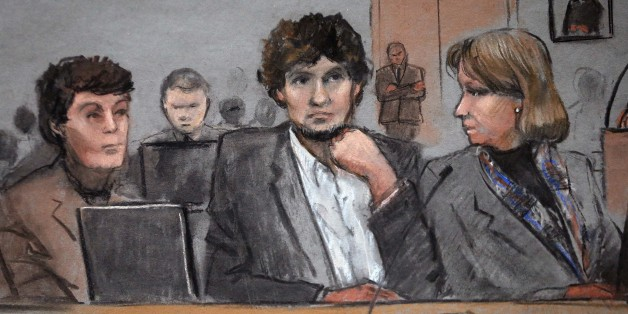 In this courtroom sketch, Dzhokhar Tsarnaev, center, is depicted between defense attorneys Miriam Conrad, left, and Judy Clarke, right, during his federal death penalty trial, Thursday, March 5, 2015, in Boston. Tsarnaev is charged with conspiring with his brother to place two bombs near the Boston Marathon finish line in April 2013, killing three and injuring 260 people. (AP Photo/Jane Flavell Collins)