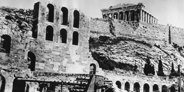 A battery of German anti-aircraft forces stops beneath the Acropolis in Athens, Greece on May 27, 1941 during World War II.  The Nazi occupation began on April 27.  (AP Photo)