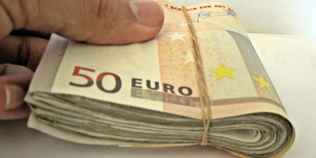"""A  wad of 50 euro notes   Like much of our work, we have put all these images in the public domain. Feel free to use them but please credit out site as the source if you do: <a href=""""http://TaxRebate.org.uk"""" rel=""""nofollow"""">TaxRebate.org.uk</a>"""