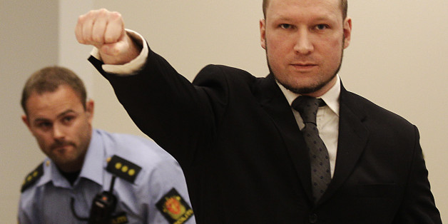 FILE - In this Aug. 24, 2012 file photo, mass murderer Anders Behring Breivik, makes a salute after arriving in the court room at a courthouse in Oslo.  Breivik, who admitted killing 77 people in Norway last year, was declared sane and sentenced to prison for bomb and gun attacks. Convicted Norwegian mass-killer  Breivik has threatened to go on hunger strike unless he gets access to better video games, a sofa and a larger gym. n a letter received by The Associated Press Tuesday Feb. 18, 2014, Br