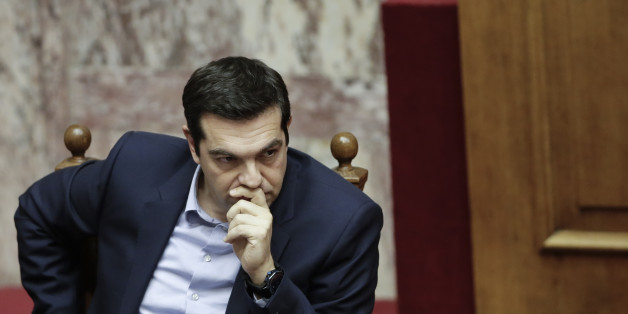 Greece's Prime Minister Alexis Tsipras attends a parliament session in Athens, on Tuesday, March 10, 2015. Tsipras spoke during a special debate on whether to revive a parliamentary committee that would seek German World War II reparations that Greece says were never fully paid. The committee would also seek the return of a forced loan  raised by Nazi occupation forces, and of Greek antiquities removed during the war. (AP Photo/Petros Giannakouris)