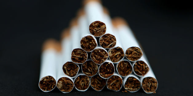 File photo dated 18/03/14 of cigarettes as the tobacco industry is financially linked to the majority of studies showing negative impacts of standardised packaging, a report claims.