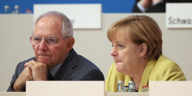 COLOGNE, GERMANY - DECEMBER 10:  German Chancellor and Chairwoman of the German Christian Democrats (CDU) Angela Merkel (R) and German Finance Minister Wolfgang Schaeuble chat at the annual CDU party congress on December 10, 2014 in Cologne, Germany. The CDU is the senior partner in Germany's ruling government coalition and yesterday delegates re-elected Merkel as party chairwoman with 96.7% of votes.  (Photo by Sean Gallup/Getty Images)