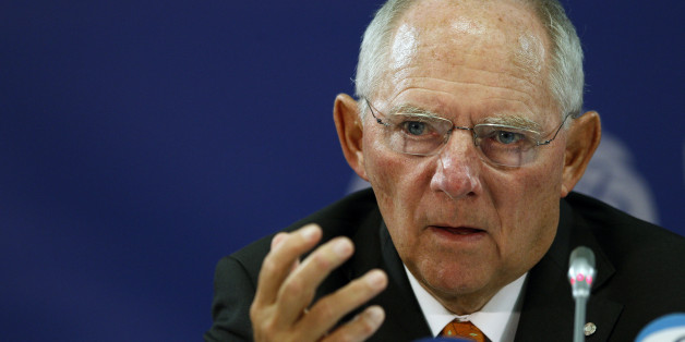 Germany's Minister of Finance Wolfgang Schauble  answer questions during a news conference  of the  Informal Meeting of Ministers for Economic and Financial Affairs (ECOFIN)  in the National Art Gallery  in Vilnius, Lithuania, Saturday, Sept. 14, 2013.  (AP Photo/Mindaugas Kulbis)