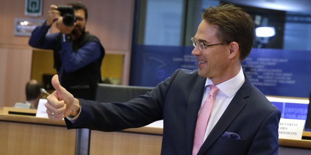 European Union Commissioner designate for Jobs, Growth, Investment and Competitiveness Jyrki Katainen shows a thumb up ahead of a hearing at the Committee on Economic and Monetary Affairs, the Committee on Employment and Social Affairs, the Committee on Industry, Research and Energy  and the Committee on Transport and Tourism and the Committee on Regional Development, at the European Parliament in Brussels, on Tuesday, Oct. 7, 2014. (AP Photo/Yves Logghe)