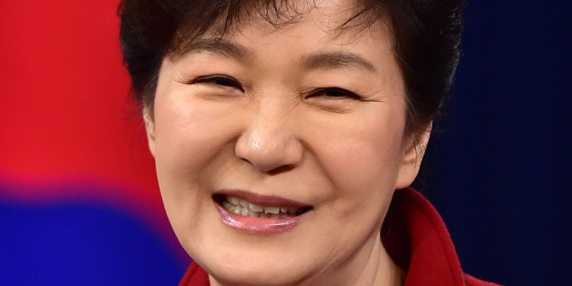 South Korean President Park Geun-hye smiles during her New Year's press conference at the presidential Blue House in Seoul Monday, Jan. 12, 2015. (AP Photo/Jung Yeon-je, Pool)