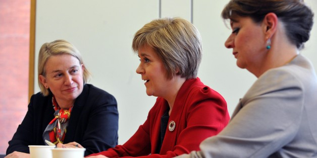 First Minister of Scotland Nicola Sturgeon (centre) during a meeting at Portculis House, central London, with the leader of the Green Party of England and Wales, Natalie Bennett (left) and the leader of Plaid Cymru Leanne Woodand, as they call for the three parties to be heard in general election debates.