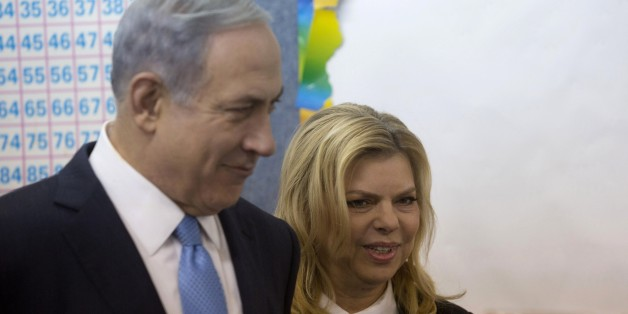 Israeli Prime Minister Benjamin Netanyahu stands with his wife Sara after voting during Israel's parliamentary elections in Jerusalem, on March 17, 2015. Israelis vote in an election expected to be a close-fought battle between the centre left and Prime Minister Benjamin Netanyahu, who ruled out a Palestinian state in a last-ditch appeal to the right. AFP PHOTO / POOL / SEBASTIAN SCHEINER        (Photo credit should read SEBASTIAN SCHEINER/AFP/Getty Images)