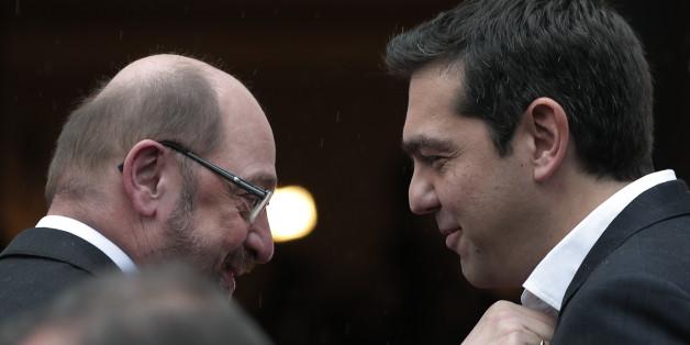 Greek Prime Minister Alexis Tsipras, right, greets European Parliament President Martin Schulz, left, at his office prior to their meeting in central Athens, Thursday, Jan. 29, 2015. (AP Photo/Lefteris Pitarakis)