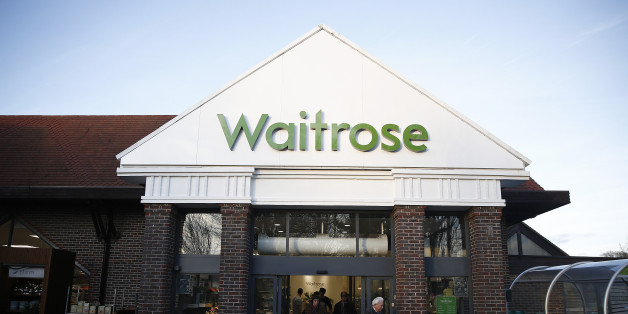 Customers push shopping carts through the entrance of a Waitrose Ltd. supermarket in the Hove district of Brighton, U.K., on Tuesday, Jan. 27, 2015. Britain has outperformed its neighbors, with the fastest economic growth in the Group of Seven industrialized nations. Photographer: Simon Dawson/Bloomberg via Getty Images