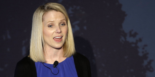 Yahoo CEO Marissa Mayer speaks during a news conference Monday, May 20, 2013, in New York. Mayer banned employees from working remotely when she took the helm of the company, but the practice is becoming more widespread. (AP Photo/Frank Franklin II)