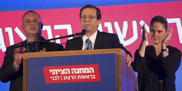 TEL AVIV, ISRAEL - MARCH 17: Zionist Union party leader Isaac Herzog delivers a speech next to his wife Michal in the party's election headquarters after the first results of the Israeli general election in Tel Aviv, Israel, on March 17, 2015. (Photo by Stringer/Anadolu Agency/Getty Images)