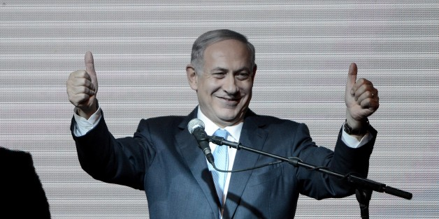 TEL AVIV, ISRAEL - MARCH 18: Israeli Prime Minister and the leader of the Likud Party Benjamin Netanyahu greets supporters at the party's election headquarters after the first results of the Israeli general election on March 18, 2015 in Tel Aviv, Israel. (Photo by Salih Zeki Fazlioglu/Anadolu Agency/Getty Images)