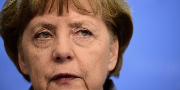 German Chancellor Angela Merkel looks on during a press conference at the end of an European Council leaders summit in Brussels on February 12, 2015.  AFP PHOTO / EMMANUEL DUNAND        (Photo credit should read EMMANUEL DUNAND/AFP/Getty Images)