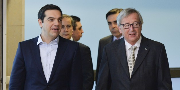 BRUSSEL, BELGIUM - MARCH 13:  European Commission President Jean-Claude Juncker (R) welcomes Greek Prime Minister Alexis Tsipras prior to a meeting at the European Commission headquarters in Brussels, Belgium, on March 13, 2015. (Photo by Dursun Aydemir/Anadolu Agency/Getty Images)