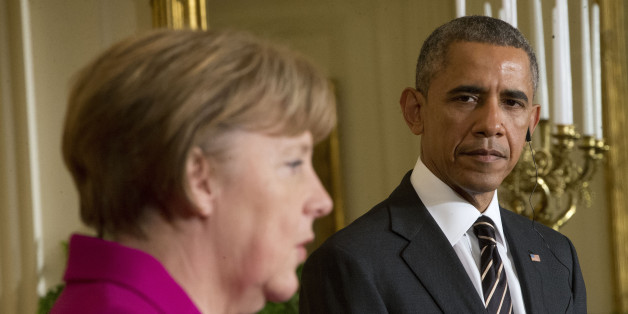 President Barack Obama listens as German Chancellor Angela Merkel speaks during their joint news conference in the East Room of the White House in Washington,  Monday, Feb. 9, 2015. The leaders were expected to discuss the ongoing conflict in Ukraine, and arming Ukrainian fighters to wage a more effective battle against Russian-backed separatists. (AP Photo/Pablo Martinez Monsivais)
