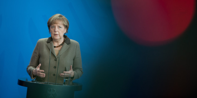German Chancellor Angela Merkel attends a news conference after a meeting with Romanian President Klaus Iohannis at the chancellery in Berlin, Germany, Thursday, Feb. 26, 2015. (AP Photo/Steffi Loos)