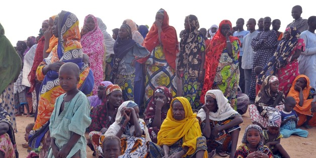 Women and children fleeing from Boko Haram attacks sit at Kabalewa Refugees Camp, Diffa in Niger Republic, on March 13, 2015. Governor of northeastern Nigerian Borno State Kashim Shettima recently visited refugee camps where Nigerians fleeing from Boko Haram Islamists attacks are sheltered in Diffa province of Niger Republic. More than 13,000 people have been killed and some 1.5 million made homeless in the Boko Haram conflict since 2009, while recent cross-border attacks from Boko Haram bases in Nigeria on neighbouring countries have increased security fears.  AFP PHOTO/OLATUNJI OMIRIN        (Photo credit should read OLATUNJI OMIRIN/AFP/Getty Images)
