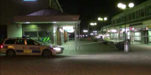 In this image from Swedish TV4 a police car sits near the Var Krog och Bar in the city of Goteborg Wdenesday night March 18, 2015. Several people were shot inside a restaurant in the city of Goteborg late Wednesday and at least two of them have died, Swedish police said.  (AP Photo/TV4)
