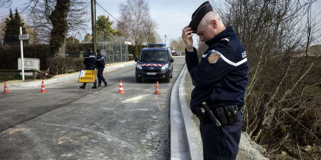 A French gendarme stands as the road is close in Avallon on March 11, 2015 after a group of 'battle-hardened' armed thieves attacked two heavily guarded vans carrying jewels at the Avallon French motorway toll in the dead of night, making off with a haul worth some nine million euros ($11 million), police said. The vans were found burnt and abandoned in a field not far from the toll station, and it was as yet unclear exactly how the assault unfolded. AFP PHOTO / JEFF PACHOUD        (Photo credit should read JEFF PACHOUD/AFP/Getty Images)