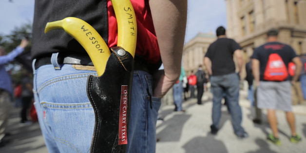 """Jason Green wears a holster with bananas marked """"Smith"""" and """"Wesson"""" at a rally in support of open carry gun laws at the Capitol, Monday, Jan. 26, 2015, in Austin, Texas. (AP Photo/Eric Gay)"""