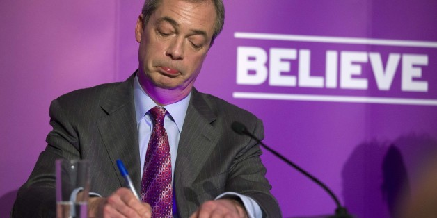 Britain's UKIP party leader Nigel Farage answers questions from the media at the Movie Starr Cinema in Canvey Island, east of London, on February 12, 2015, as he makes his first major speech of the 2015 General Election. AFP PHOTO/JUSTIN TALLIS        (Photo credit should read JUSTIN TALLIS/AFP/Getty Images)