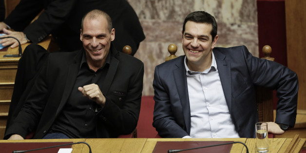 Greece's Prime Minister Alexis Tsipras and Greece's Finance Minister Yanis Varoufakis smile during a Presidential vote in Athens, on Wednesday, Feb. 18, 2015. Greece's parliament has elected conservative law professor and veteran politician Prokopis Pavlopoulos as the country's next president, after he received support from the new left-wing government and main center-right opposition party.(AP Photo/Petros Giannakouris)