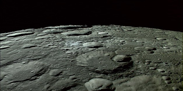 In this photo made out of an Oct. 31, 2007 HDTV image released by Japan Aerospace Exploration Agency (JAXA) and Japan's national broadcaster NHK, craters on the North Pole on the moon are shown. The still photo released on Wednesday, Nov. 7, 2007, was made out of the HDTV images of the moon taken for the first time in the world by an HDTV camera, developed specially by NHK for the use in the space and installed on Japan's first lunar probe SELENE's main satellite in orbit at an altitude of about 100 kilometers (60 miles), Tokyo-based JAXA and NHK said in their release Wednesday. (AP Photo/Japan Aerospace Exploration Agency and NHK, HO) **CREDIT MANDATORY TO JAXA/NHK, EDITORIAL USE ONLY**