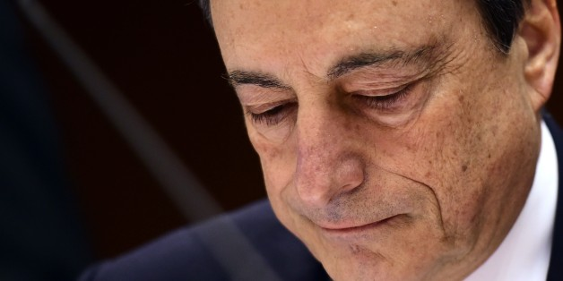 European Central Bank President Mario Draghi looks on before delivering introductory remarks in front of the Economic and Monetary Affairs Committee at the European Parliament, in Brussels, on March 23, 2015. AFP PHOTO / EMMANUEL DUNAND        (Photo credit should read EMMANUEL DUNAND/AFP/Getty Images)