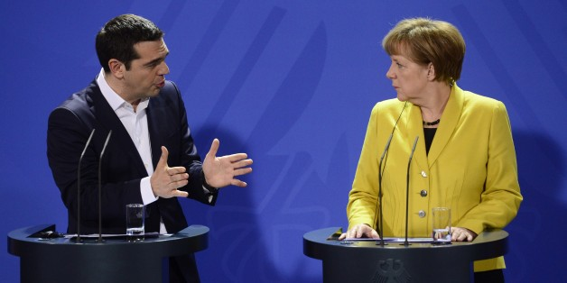 German Chancellor Angela Merkel (R) and Greek Prime Minister Alexis Tsipras address a press conference following talks at the chancellery in Berlin, on March 23, 2015. AFP PHOTO / JOHN MACDOUGALL        (Photo credit should read JOHN MACDOUGALL/AFP/Getty Images)