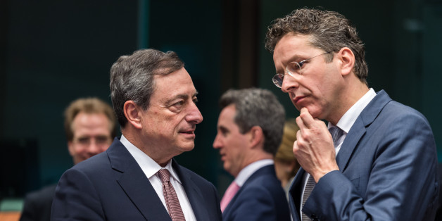 Dutch Finance Minister Jeroen Dijsselbloem, right, talks with European Central Bank Governor Mario Draghi during a meeting of eurogroup finance ministers at the European Council building in Brussels, Monday March 9, 2015. (AP Photo/Geert Vanden Wijngaert)