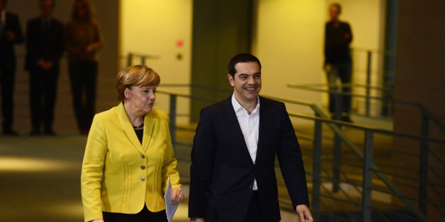 German Chancellor Angela Merkel (L) and Greek Prime Minister Alexis Tsipras arrive to address a press conference following talks at the chancellery in Berlin, on March 23, 2015. AFP PHOTO / JOHN MACDOUGALL        (Photo credit should read JOHN MACDOUGALL/AFP/Getty Images)