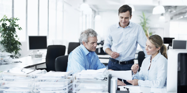 Three businesspeople working together in their office