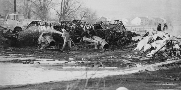 FILE - In this Jan. 21, 1985, file photo, a fireman hoses down an aircraft wreckage, Galaxy Airlines Flight 203 crashed on take off from Cannon International Airport in Reno. The lone survivor of the 1985 airplane crash that killed 70 people who were returning from a Super Bowl junket says he can't bring himself to attend a memorial on the 30th anniversary of the disaster. George Lamson Jr. was 17 when flight crashed. (AP Photo/Sal Veder, File)