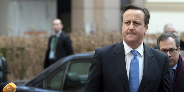 British Prime Minister David Cameron, center, arrives for an EU summit in Brussels on Thursday, Feb. 12, 2015. EU leaders meet for a one-day summit on Thursday to discuss, among other issues, European banks and the situation in Ukraine.(AP Photo/Virginia Mayo)