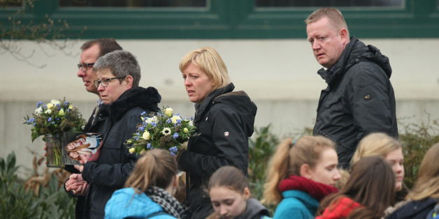 HALTERN, GERMANY - MARCH 25:  Mourners arrive at the Joseph-Koenig-Gymnasium high school to pay tribute to 16 students and two teachers from the school who were on Germanwings flight 4U9525 that crashed yesterday in southern France on March 25, 2015 in Haltern, Germany. All 144 passengers and six flight crew are presumed dead and authorities are investigating the possible cause of the accident.  (Photo by Sean Gallup/Getty Images)