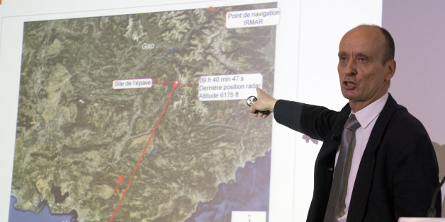 Remi Jouty, director of BEA, the French Air Accident Investigation Agency displays the trajectory of the crashed jetliner during a press conference at Le Bourget airport, north of Paris, Wednesday, March 25, 2015.  The Germanwings jetliner crashed Tuesday in the French Alps. French investigators cracked open the badly damaged black box of the German jetliner on Wednesday and sealed off the rugged Alpine crash site where 150 people died when their plane on a flight from Barcelona, Spain, to Duess