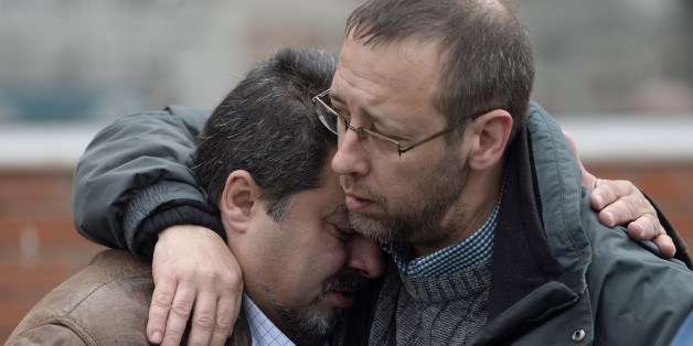 Workers from the Delphi factory, who lost two colleagues in the Germanwings flight crash, grieve after a minute of silence in Sant Cugat del Valles, near Barcelona, Spain, Wednesday, March 25, 2015. Germanwings Flight 9525 from Barcelona to Duesseldorf crashed Tuesday, April 24, in France. A total of 67 Germans, many Spaniards, and people from Australia, Japan, Israel, Turkey, Denmark and the Netherlands are believed to be among the 150 on board who died. (AP Photo/Manu Fernandez)