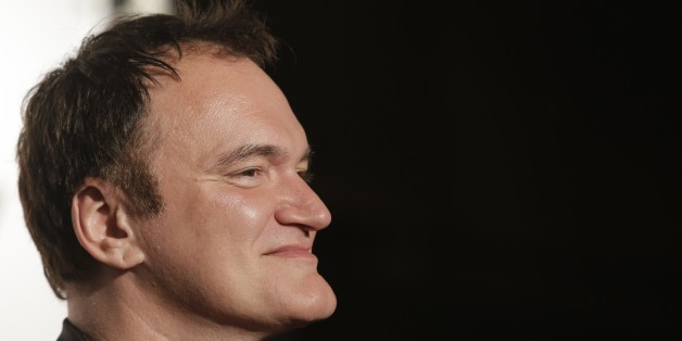 Director Quentin Tarantino looks on as he arrives at the opening ceremony of the 5th edition of the Lumiere Festival, in Lyon, central France, Monday, Oct. 14, 2013. (AP Photo/Laurent Cipriani)