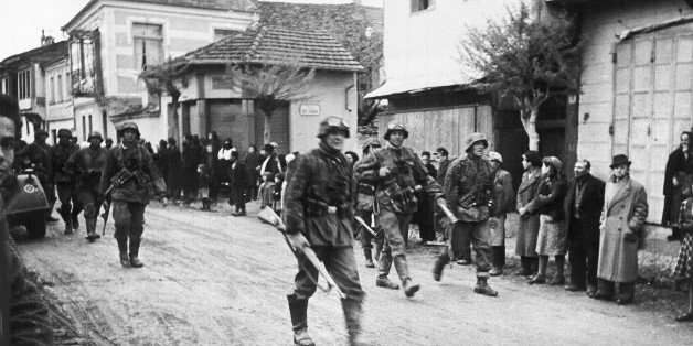 A squad of German soldiers pass through a Greek village, during the occupation of Greece, in May 1941. (AP Photo)