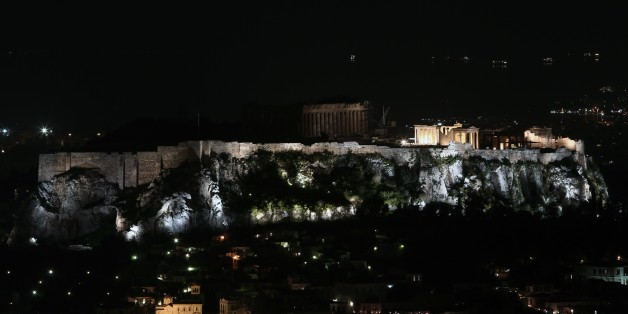 This picture shows the ancient Temple of Parthenon atop Acropolis hill in partial darkness during the Earth Hour initiative in Athens on March 28, 2015. Millions are expected to take part around the world in the annual event organised by conservation group WWF, with hundreds of well-known sights set to plunge into darkness.  AFP PHOTO / ANGELOS TZORTZINIS        (Photo credit should read ANGELOS TZORTZINIS/AFP/Getty Images)