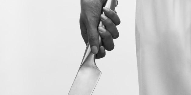 Man's hand holding large hand gun, close up
