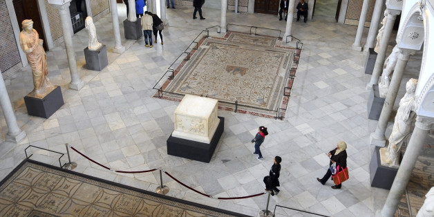 Tunisians stroll in Tunisia's National Bardo Museum Monday, March 30, 2015. The Bardo Museum is open to the public again for the first time since extremist gunmen opened fire on foreign tourists earlier this month, killing 22 people in the country's worst attack on civilians in 13 years. (AP Photo/Hassene Dridi)