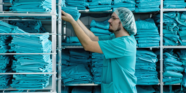 Stacking shelves with scrubs in hospital laundry
