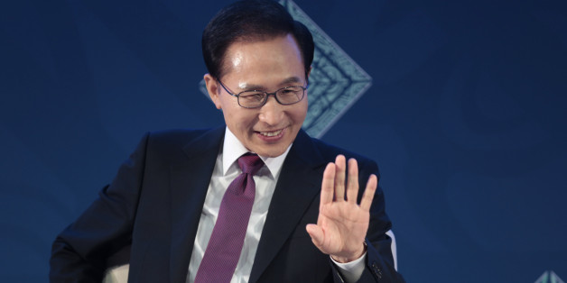 South Korea's President Lee Myung-bak waves as he participates in a panel during a B20 meeting prior to the G20 Summit in Los Cabos, Mexico, Monday, June 18, 2012. (AP Photo/Esteban Felix)