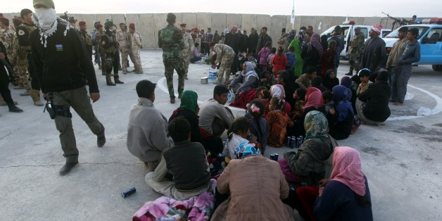 Displaced Iraqi Sunni families who fled the villages of of Albu Ajil and Al-Dor due to fighting between Islamic State (IS) group militants and government forces surrounding the northern Iraqi city of Tikrit, rest after arriving at an army camp in the city of Samarra to take refuge on March 8, 2015. Iraqi forces faced tough resistance from jihadist fighters around Tikrit, but top US military officer General Martin Dempsey said ahead of a Baghdad visit that victory was only a matter of time. AFP PHOTO / AHMAD AL-RUBAYE        (Photo credit should read AHMAD AL-RUBAYE/AFP/Getty Images)