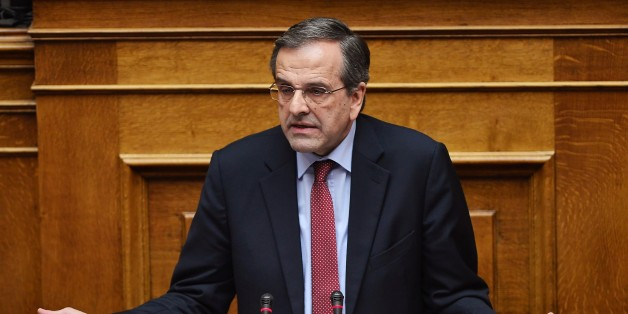 Greece main opposition party leader, Antonis Samaras speaks  during a parliament session ahead of the confidence vote of the new government on February 10, 2015 in Athens. Greece's new leftist government fine-tuned a 10-point plan aimed at persuading its international creditors to reluctantly rethink their bailout terms and prevent the country from going bust. AFP PHOTO/ LOUISA GOULIAMAKI        (Photo credit should read LOUISA GOULIAMAKI/AFP/Getty Images)