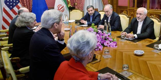 From left:  Robert Malley, of the US National Security Council, US Secretary of Energy Ernest Moniz, US Secretary of State John Kerry, US Under Secretary for Political Affairs Wendy Sherman, Iranian Deputy Foreign Minister Abbas Araghchi, Head of Iranian Atomic Energy Organization Ali Akbar Salehi and Iranian Foreign Minister Mohammad Javad Zarif wait for a meeting, Friday, March 27, 2015 in Lausanne, Switzerland. The Iranian and US officials are in Switzerland to continue negotiations on the Iranian nuclear program. (AP Photo/Brendan Smialowski, Pool)