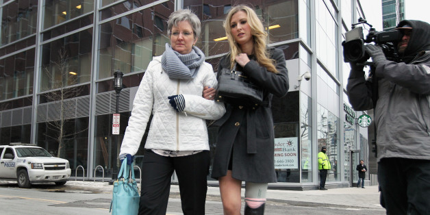 BOSTON - MARCH 5: Boston Marathon bombing victim, Rebekah Gregory, right, arrived at Moakley Federal Courthouse in Boston, where the second day in the trial of Dzhokhar Tsarnaev got underway on March 5, 2015. (Photo by Wendy Maeda/The Boston Globe via Getty Images)